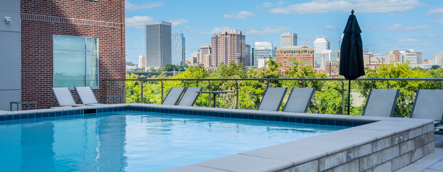 swimming pool on terrace with city views