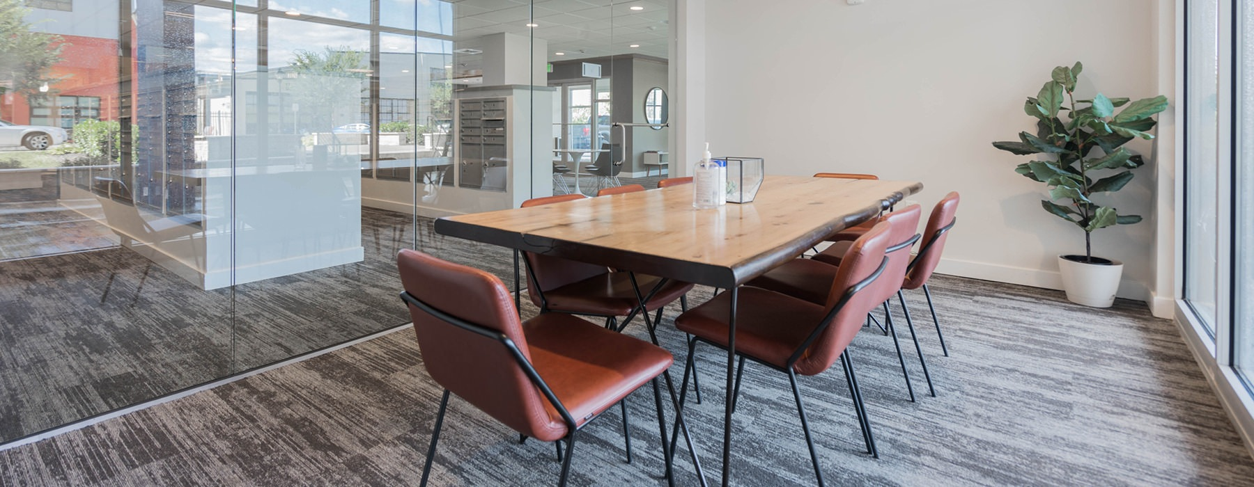 glass enclosed conference room with floor-to-ceiling windows