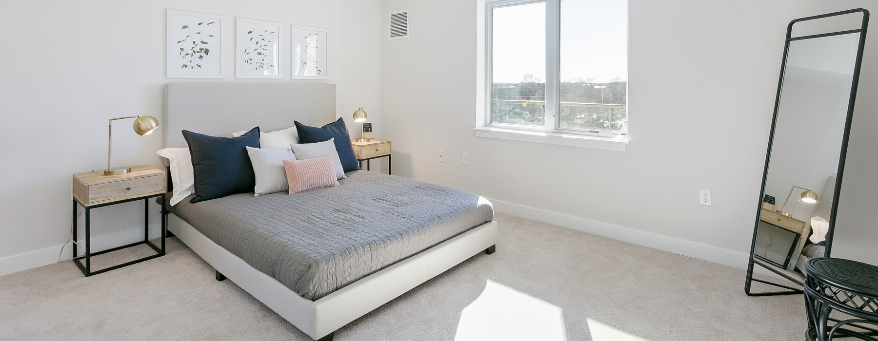 natural lighting fills large bedroom