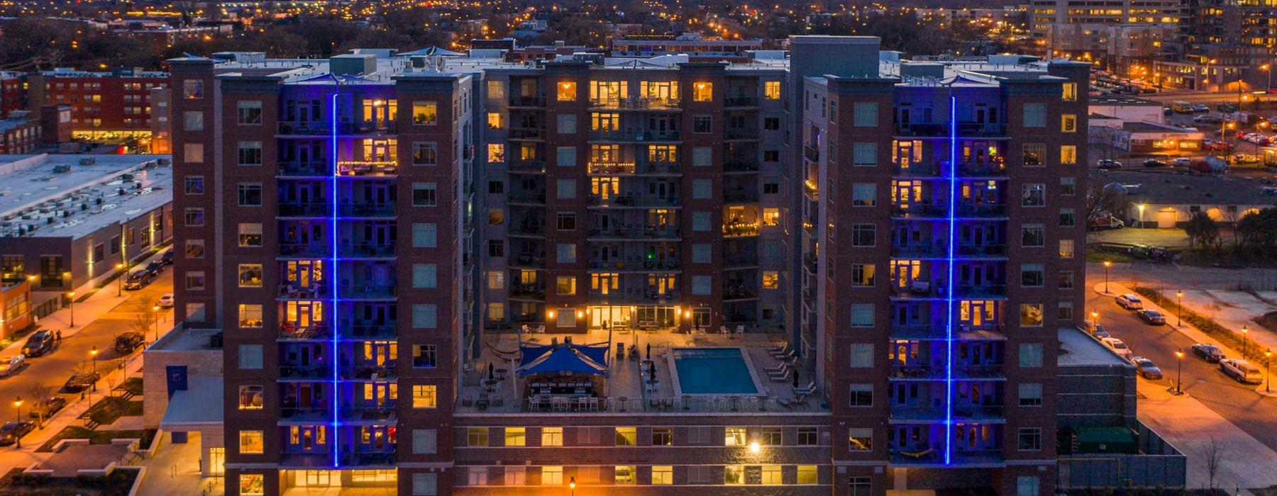 evening shot of River's Edge building lit up